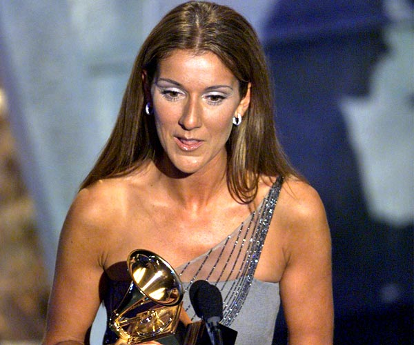 Celine Dion accepts her Grammy for record of the year at the 41st Grammy Awards in Los Angeles.