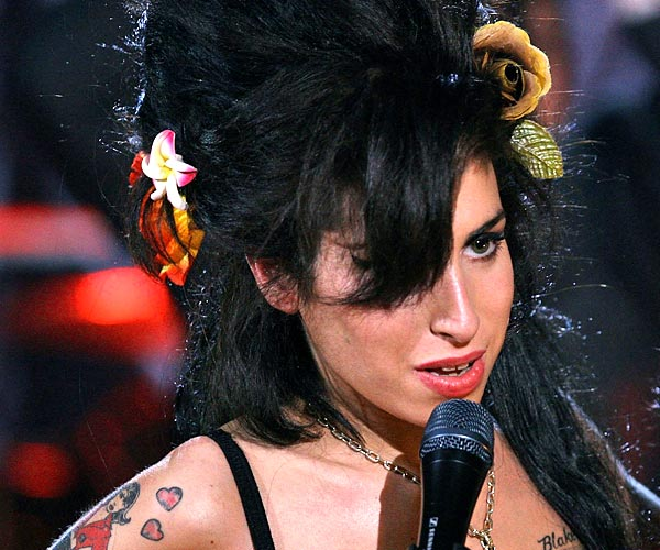 After her live performance from London, Amy Winehouse celebrates her win at the 50th Grammy Awards.