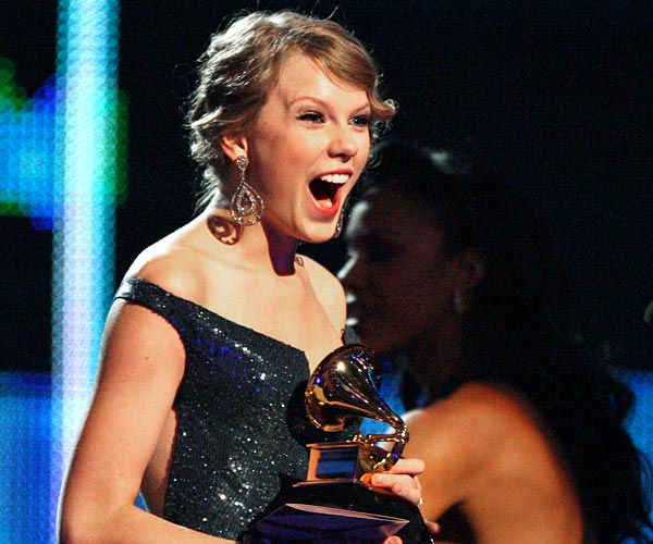 Taylor Swift reacts after winning four Grammys at the 52nd Grammy Awards in Los Angeles.