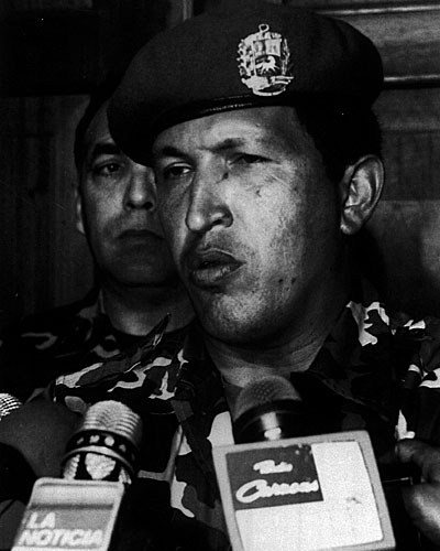 Leader of the Bolivarian Revolution 2000, Hugo Chavez, talks to reporters at the Defense Ministry after he surrendered to the troops loyal to Carlos Andres Perez.