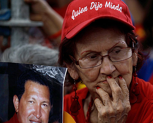 A woman holds an image of Venezuela's President Hugo Chavez during a demonstration in support of him at the Simon Bolivar square in Caracas, Venezuela.