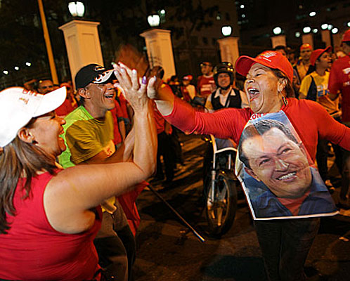 Supporters of President Hugo Chavez celebrate in Caracas after polls close. Poor and working-class voters were solidly behind him.