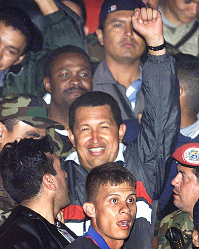 Venezuelan President Hugo Chavez is greeted by supporters upon his return to the presidential palace  in Caracas.