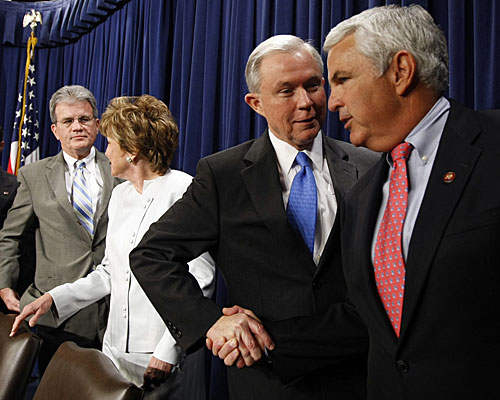 Sen. Jeff Sessions (R-Ala.), second from right, greets Rep. John Shadegg (R-Ariz.) at a news conference attended by other senators who opposed the legislation.