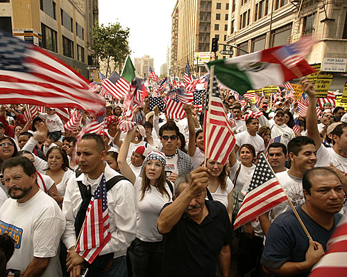 Immigrants and supporters gather at Olympic Boulevard and Broadway in one of two Los Angeles marches that attracted hundreds of thousands of demonstrators.