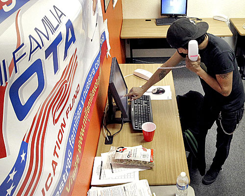 Pedro Yazzie makes phone calls in Phoenix to registered voters from the offices of Mi Familia Vota, a non-partisan effort to increase voter participation among Latinos and others.