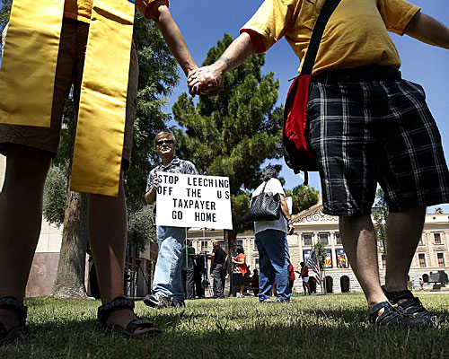 Supporters of the get-tough effort on illegal immigration demonstrate at the Arizona Capitol.
